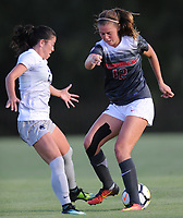 NWA Democrat-Gazette/ANDY SHUPE<br /> Arkansas' Kayla McKeon (right) attempts to push the ball past Penn State's Marissa Sheva Friday, Aug. 25, 2017, during the Razorbacks' 4-2 loss at Razorback Field in Fayetteville. Visit nwadg.com/photos to see more photographs from the match.