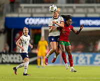 HOUSTON, TX - JUNE 10: Lindsey Horan #9 of the USWNT goes up for a header with Carole Costa #15 of Portugal during a game between Portugal and USWNT at BBVA Stadium on June 10, 2021 in Houston, Texas.