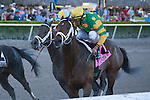 Palace Malice and jockey John Velasquez (yellow cap) hang on to edge out Golden Ticket (orange cap) and Uncaptured (middle)to win the Gulfstream Park Handicap (G2). Gulfstream Park, Hallandale Beach Florida. 02-08-2014