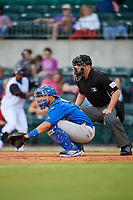 Midland RockHounds catcher Argenis Raga (8) and home plate umpire Sean Allen during a game against the Arkansas Travelers on May 25, 2017 at Dickey-Stephens Park in Little Rock, Arkansas.  Midland defeated Arkansas 8-1.  (Mike Janes/Four Seam Images)