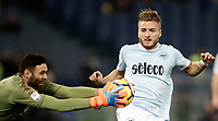 Calcio, Serie A: Roma, stadio Olimpico, 11 dicembre 2017.<br /> Lazio's Ciro Immobile (r) in action with Torino's goalkeeper Salvatore Sirighu (l) during the Italian Serie A football match between Lazio and Torino at Rome's Olympic stadium, December 11, 2017.<br /> UPDATE IMAGES PRESS/Isabella Bonotto
