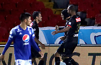 BOGOTA - COLOMBIA, 19-09-2020: Andres Felipe Correa del Once celebra con sus compañeros después el tercer gol de su equipo durante partido entre Millonarios y Once Caldas por la fecha 9 de la Liga BetPlay DIMAYOR 2020 jugado en el estadio Nemesio Camacho El Campin de la ciudad de Bogotá. / Andres Felipe Correa of Once celebrates with his teammates after scoring the third goal of his team during match between Millonarios and Once Caldas for the date 9 of the BetPlay DIMAYOR League 2020 played at the Nemesio Camacho El Campin Stadium in Bogota city. Photo: VizzorImage / Santiago Cortes / Cont.