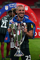 Michael Harriman of Northampton Town celebrates promotion to League One with the trophy after a 4-0 victory in the Sky Bet League 2 PLAY-OFF Final match between Exeter City and Northampton Town at Wembley Stadium, London, England on 29 June 2020. Photo by Andy Rowland.