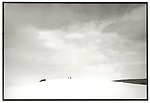Scan of vintage print. Snowy hillside with two figures in distance. Miller property. 1970's. 1 of 1;