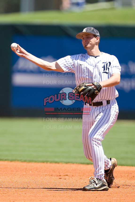 Rice Owls shortstop Derek Hamilton #4 throws the ball to first against the Memphis TIgers in NCAA Conference USA baseball on May 14, 2011 at Reckling Park in Houston, Texas. (Photo by Andrew Woolley / Four Seam Images)