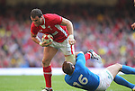 Tommaso D'Apice does enough to stop Jamie Roberts..2012 RBS 6 Nations.Wales v Italy.Millennium Stadium..10.03.12.Credit: STEVE POPE-Sportingwales