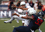Nevada's Jarred Gipson watches quarterback Tyler Stewart get sacked by Arizona's Jeff Worthy in an NCAA college football game in Reno, Nev., on Saturday, Sept. 12, 2015.(AP Photo/Cathleen Allison)