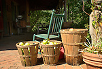Apples in baskets on farmhouse porch