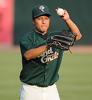Pitcher Angel Cuan (18) of the Savannah Sand Gnats, Class A affiliate of the New York Mets, prior to a game against the West Virginia Power on July 21, 2011, at Grayson Stadium in Savannah, Georgia. (Tom Priddy/Four Seam Images)