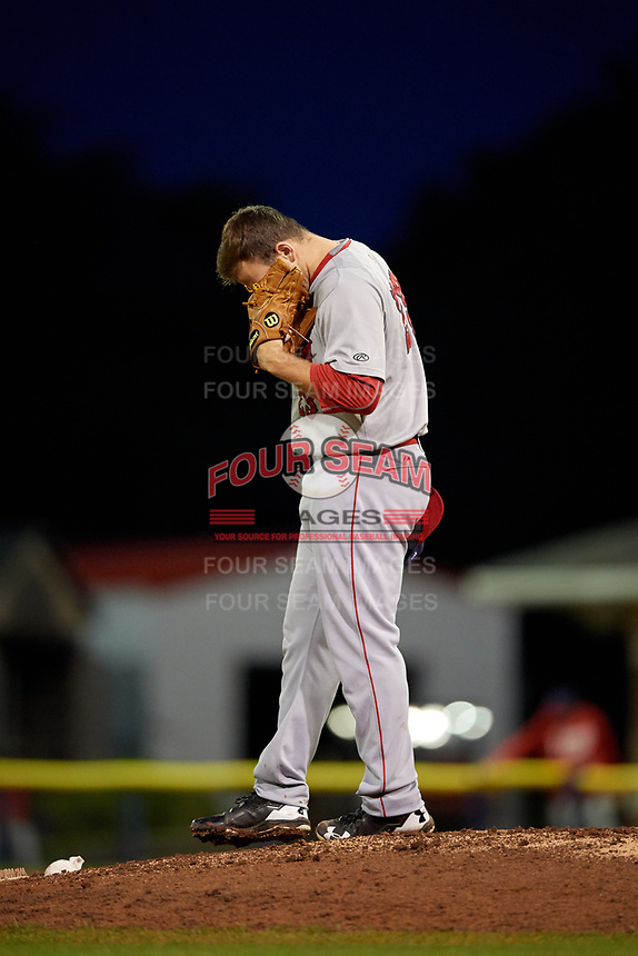 Auburn Doubledays starting pitcher Wil Crowe (23) cleans off his spikes during a game against the Batavia Muckdogs on September 6, 2017 at Dwyer Stadium in Batavia, New York.  Auburn defeated Batavia 6-3.  (Mike Janes/Four Seam Images)