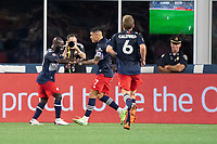 FOXOBOROUGH, MA - AUGUST 21: Emmanuel Boateng #11 of New England Revolution celebrates his goal during a game between FC Cincinnati and New England Revolution at Gillette Stadium on August 21, 2021 in Foxoborough, Massachusetts.