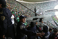 Mexican police officers hold up their shields from flying objects thrown by Mexican fans at Azteca stadium. The United States Men's National Team played Mexico in a CONCACAF World Cup Qualifier match at Azteca Stadium in, Mexico City, Mexico on Wednesday, August 12, 2009.
