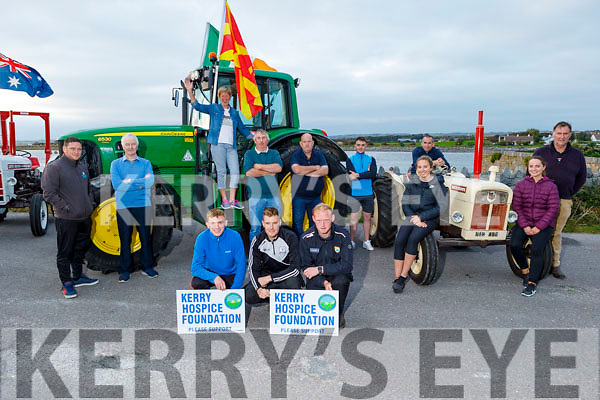 """The Blennerville Threshing committee launch their Tractor Run fundraiser  """"Into the West"""" for the Kerry Hospice on Monday evening, the tractor run is due to the fact that Covid has cancelled the Trashing Festival and the run is going ahead at 12 o'clock Sunday in Blennerville. Kneeling: David and Sean Kerins and Tim Daly. Back l to r: Donal Coppinger, Tadgh Kerins, Denis Murphy, Donal O'Riordan, Kieran O'Shea, Karen Walsh, Siobhan Ryan and John Kerins. Standing on the tractor is Maura O'Sullivan."""