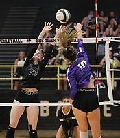 Sophie Snodgrass (10 of Fayetteville spikes ball against Maddie Lee (23) of Bentonville on Thursday, Oct.  7, 2021, during play at Tiger Arena in Bentonville. Visit nwaonline.com/211008Daily/ for today's photo gallery.<br /> (Special to the NWA Democrat-Gazette/David Beach)