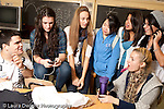 Education High School group of students socializing during lunch break, in classroom
