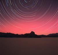 NIGHT SKY turning around NORTH STAR above DEATH VALLEY - CALIFORNIA