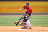 Eric Garcia (12) of the Carolina Mudcats is upended by Adam Engel (7) of the Winston-Salem Dash as he slides into second base at BB&T Ballpark on April 22, 2015 in Winston-Salem, North Carolina.  The Dash defeated the Mudcats 4-2..  (Brian Westerholt/Four Seam Images)