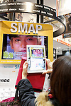 A fan takes a picture of an exhibit space for the SMAP's new album SMAP 25 YEARS at the Tsutaya store in Shibuya on December 22, Tokyo, Japan. Japan's most popular boy band announced that they would split by the end of the year, and the special album includes 50 of the band's songs as selected by fans. (Photo by Rodrigo Reyes Marin/AFLO)