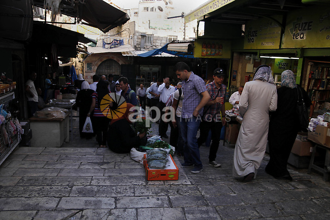 Palestinians walk at the the market of Damascus gate in Jerusalem's Old City, June 26, 2013. Photo by Saeed Qaq