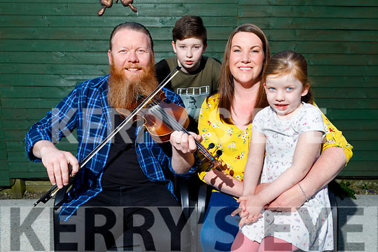 Well known fiddle player Noel McAuliffe with his wife Liz, son Jack and daughter Sarah at home in Tralee on Thursday