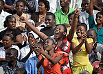 Young women respond enthusiastically as Christian musician Michael W. Smith sings to a crowd in Port-au-Prince, Haiti. Just before the one-year anniversary of the January 2010 earthquake that ravaged Port-au-Prince, Franklin Graham, the conservative U.S. evangelical leader, preached to a rally at the national soccer stadium. Smith sang before Graham appeared. .