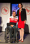 Calgary, AB - June 5 2014 - Mark Ideson receives his Paralympic ring from Monique Giroux, of CIBC, during the Celebration of Excellence Paralympic Ring Reception in Calgary. (Photo: Matthew Murnaghan/Canadian Paralympic Committee)