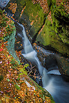 Autumn leaves surround a small waterfall where Skillet Creek cuts through Pewit's Nest near Baraboo, Wisconsin