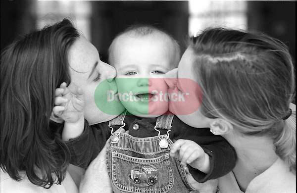 two women kissing baby boy