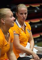 The Netherlands, Den Bosch, 16.04.2014. Fed Cup Netherlands-Japan, training, Kiki Bertens (L) and Richel Hogenkamp (NED) <br /> Photo:Tennisimages/Henk Koster