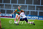 Kerry's Niamh Ní Chonchúir about to raise the green flag as she slips one past the Wexford keeper Sarah Merrigan in the Lidl LGFA National football league game in Fitzgerald Stadium Killarney on Sunday.