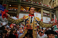Matadors David Mora celebrates after cutting two bull ears during the San Fermin festival, on July 10, 2012, in the Northern Spanish city of Pamplona. The festival is a symbol of Spanish culture that attracts thousands of tourists to watch the bull runs despite heavy condemnation from animal rights groups. (c) Pedro ARMESTRE