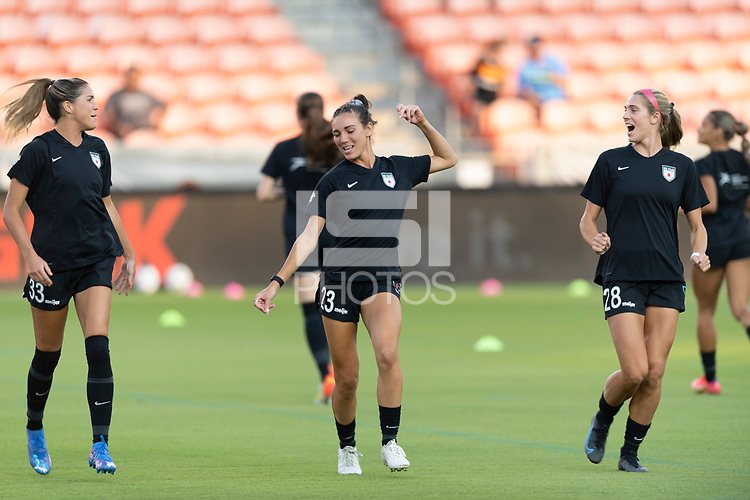 HOUSTON, TX - SEPTEMBER 10: Katie Johnson #33, Tatumn Milazzo #23 and Kayla Sharples #28 of the Chicago Red Stars warming up before a game between Chicago Red Stars and Houston Dash at BBVA Stadium on September 10, 2021 in Houston, Texas.