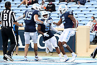 CHAPEL HILL, NC - OCTOBER 10: Dyami Brown #2 of North Carolina celebrates his 43-yard touchdown reception with teammates Beau Corrales #15 and Dazz Newsome #5 during a game between Virginia Tech and North Carolina at Kenan Memorial Stadium on October 10, 2020 in Chapel Hill, North Carolina.