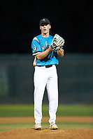 Mooresville Spinners relief pitcher Jack Fisher (4) (UNC Wilmington) looks to his catcher for the sign against the Concord A's at Moor Park on July 31, 2020 in Mooresville, NC. The Spinners defeated the Athletics 6-3 in a game called after 6 innings due to rain. (Brian Westerholt/Four Seam Images)