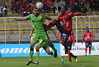 BOGOTA - COLOMBIA - 21 - 10 - 2017: Francisco Najera (Izq.) jugador de La Equidad disputa el balón con Juan Caicedo (Der.) jugador del Independiente Medellín, durante partido entre La Equidad y el Indeendiente Medellín,  por la fecha 16 de la Liga Aguila II-2017, jugado en el estadio Metropolitano de Techo de la ciudad de Bogota. / Francisco Najera (L) player of La Equidad vies for the ball with Juan Caicedo (R) player of Independiente Medellin, during a match between La Equidad and Indepndiente Medellin, for the  date 16nd of the Liga Aguila II-2017 at the Metropolitano de Techo Stadium in Bogota city, Photo: VizzorImage  /Felipe Caicedo / Staff.
