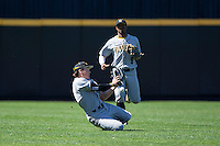 Kennesaw State Owls left fielder Griffin Helms (34) can't make the sliding catch of this fly ball during the game against the Winthrop Eagles at the Winthrop Ballpark on March 15, 2015 in Rock Hill, South Carolina.  The Eagles defeated the Owls 11-4.  (Brian Westerholt/Four Seam Images)
