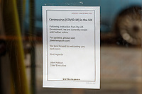 Pictured: A Covid-19 announcement at the Potter's Wheel pub, owned by JD Wetherspoon in Swansea, Wales, UK. Saturday 21 March 2020<br /> Re: Covid-19 Coronavirus pandemic, UK.