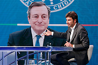 Former deputy of Movement 5 Stars and writer Alessandro Di Battista appears as a guest on the talk show Porta a Porta to present his new book 'Contro'. In the background, on the screen, Mario Draghi.<br /> Rome (Italy), May 25th 2021<br /> Photo Samantha Zucchi Insidefoto