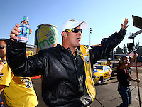 Nov 10, 2013; Pomona, CA, USA; NHRA pro stock driver Jeg Coughlin Jr celebrates after clinching the 2013 pro stock championship during the Auto Club Finals at Auto Club Raceway at Pomona. Mandatory Credit: Mark J. Rebilas-
