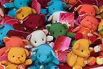 A window display of teddy bears in Tokyo creates a rainbow of colors.