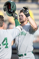 Eastern Michigan Eagles outfielder Mike Mioduszewski (15) is greeted at the plate by teammate John Montgomery (44) after hitting a home run during the NCAA baseball game against the Michigan Wolverines on May 16, 2017 at Ray Fisher Stadium in Ann Arbor, Michigan. Michigan defeated Eastern Michigan 12-4. (Andrew Woolley/Four Seam Images)