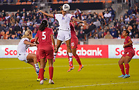 HOUSTON, TX - JANUARY 31: Jessica McDonald #14 of the United States leaps high for a head ball during a game between Panama and USWNT at BBVA Stadium on January 31, 2020 in Houston, Texas.