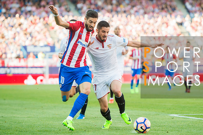 Yannick Ferreira Carrasco (l) of Atletico de Madrid battles for the ball with Pablo Sarabia Garcia of Sevilla FC during their La Liga match between Atletico de Madrid and Sevilla FC at the Estadio Vicente Calderon on 19 March 2017 in Madrid, Spain. Photo by Diego Gonzalez Souto / Power Sport Images