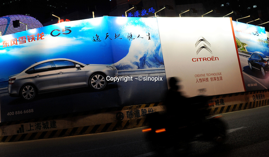 An advertisment for the Dong Feng Citroen C5 in downtown Shanghai, China..