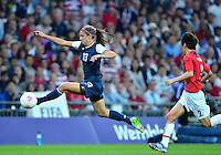 August 09, 2012: United States' Alex Morgan and Japan's Yukari Kinga in action during Women's Football Final match at the Wembley Stadium on day thirteen in Wembley, England. USA defeat Japan 2-1 to win it's third consecutive Olympic gold medal in women's soccer. ..