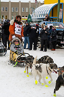 Brent Sass and team leave the ceremonial start line with an Iditarider and handler at 4th Avenue and D street in downtown Anchorage, Alaska on Saturday March 7th during the 2020 Iditarod race. Photo copyright by Cathy Hart Photography.com