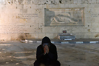 Pictured: A protester holds his head in his hands infront of the Unknown Soldier monument outside the Parliament Thursday 18 May 2017<br /> Re: Clashes between anti fourth memorandum protesters and riot police in front of the Parliament building in Syntagma Square, Athens, Greece
