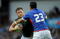 Duane Vermeulen of South Africa is tackled by George Pisi just short of the line during Match 15 of the Rugby World Cup 2015 between South Africa and Samoa - 26/09/2015 - Villa Park, Birmingham<br /> Mandatory Credit: Rob Munro/Stewart Communications