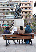 Pictured: Four women wearing scarves in Victoria Square Wednesday 09 March 2016<br /> Re: Migrants at Victoria Square, in central Athens, Greece.