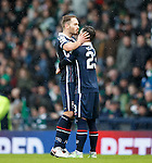 Martin Woods celebrates scoring from the spot and kisses Alex Schalk